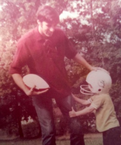 Dad and me, circa 1972 or '73. Note the Dolphins helmet. And the sideburns.
