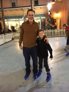 My first time on ice skates, at the Now Snowing Christmas event in the Town of Celebration. It took some convincing, but Jay finally joined me. He looks pretty happy about it, doesn't he?